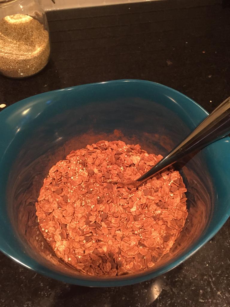 mixing healthy homemade chocolate granola