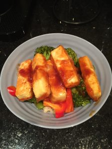 A yummy sweet and sour tofu dish with veggies and quinoa