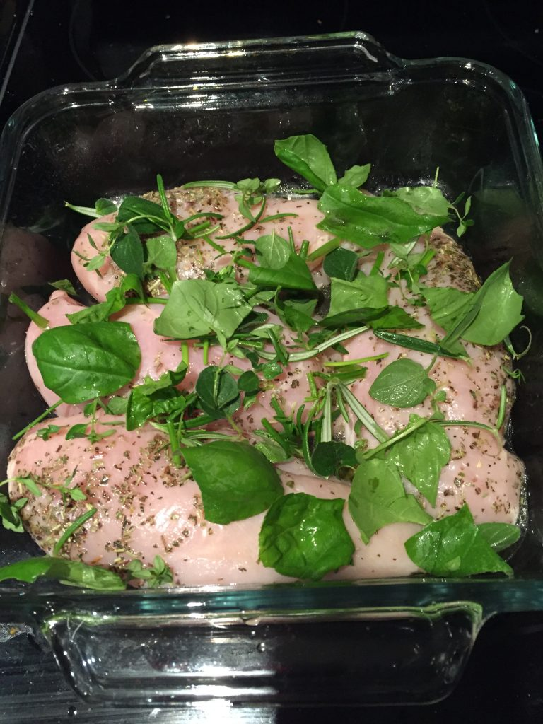Chicken with dried and fresh herbs ready for the oven for a low iodine diet dinner