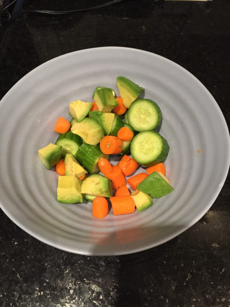 chopped avocado cucumber and carrots for sushi bowls