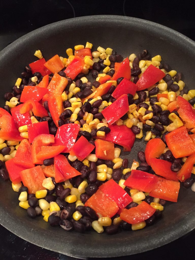 Add the chopped red peppers and cook all together to make the BBQ Chicken Burrito Bowls