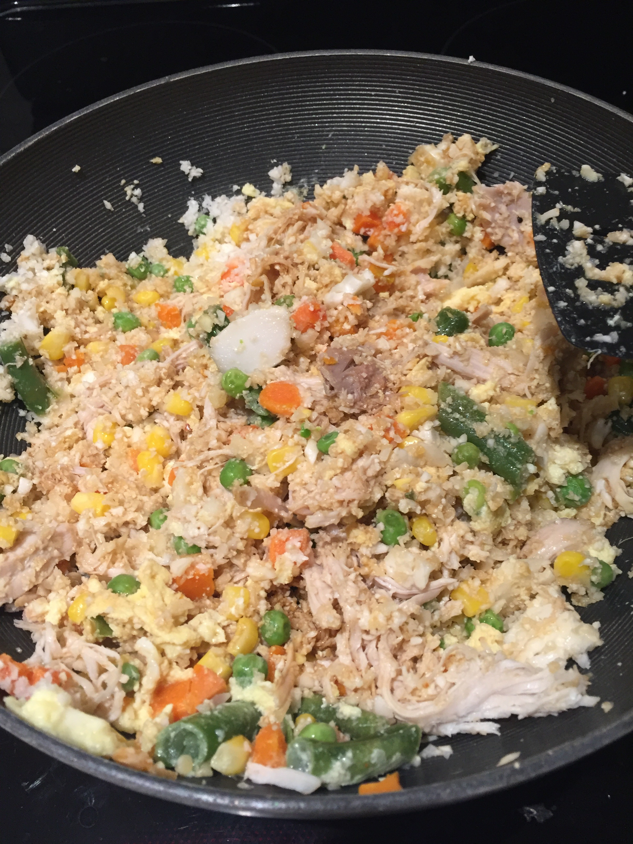 Mix up the leftover turkey with the sauce, cauliflower rice and veggies